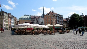 A beautiful square in Riga. Look at the painted house walls!