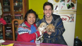 Erika and Jonathan with the two cute little puppies that lives here in this house. There are for adoption!