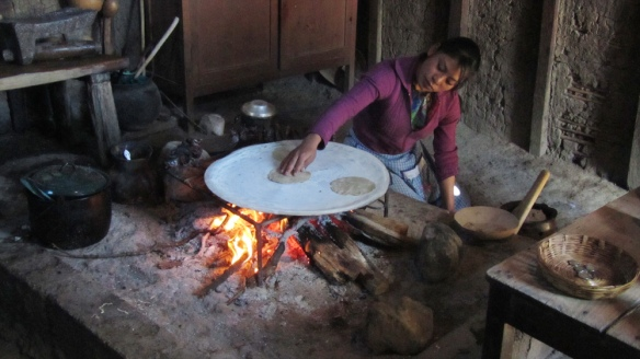 In zinacantán, a woman is making us tortillas in their kitchen. The white thing on the pan gives them kalcium, because they can't drink milk, they are laktos intolerant.