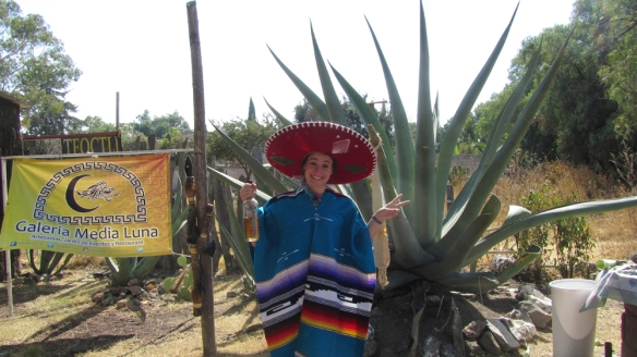 In front of the maguey plant, with typical mexican clothing.. haha