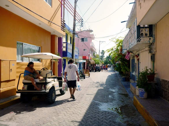 Wandering around in Isla Mujeres.  We live in that pink  building on the left.