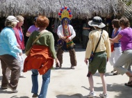 The guy is showing traditional ecuatorian dance to some tourists haha. He also has traditional clothes. Maximiliano has a pair of those pants!