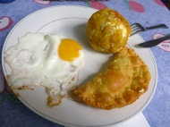 Lunch.... very nutritive! Haha. That's what they had that was vegetarian.... empanada, bolón and eggs... yes.. they eat very much fat here..