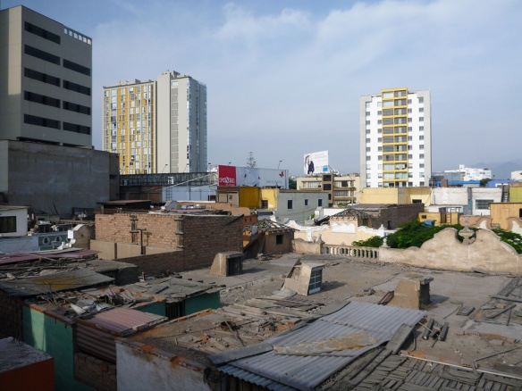View over some roof tops and some other buildings. Taken from the roof of the hostel.