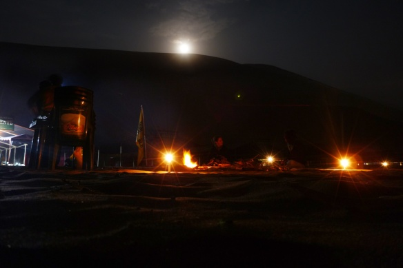 Our birthday party at the beach, with the full moon rising above the hills...