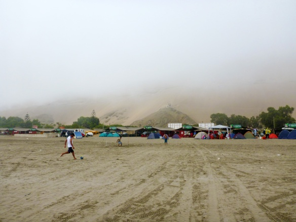 Foggy beach with tents