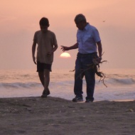 Father and son in sunset