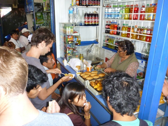Buying some salteños in the market of Camilo, they even had vegetarian ones!