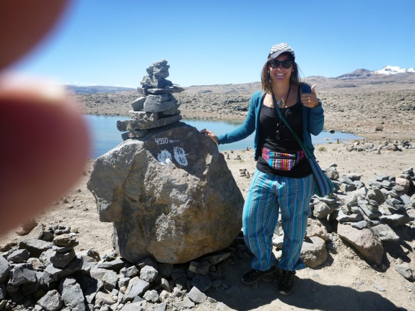 I think this pic is charming :) Love the finger haha. On our way to the Colca Valley, quite high above sea level. They put the stones like this to make a wish and then the stones will attract energies from the mountains around.