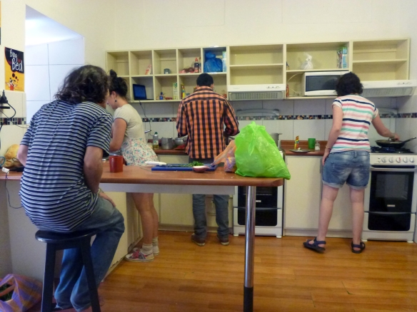 Facu, Nadia, Jorge and Shir cooking in the kitchen