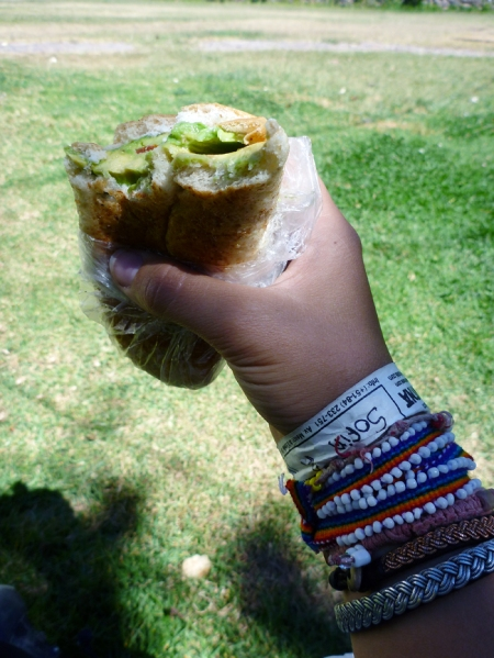 Having my avocado sandwish :) Also showing of my new bracelet I bought in the market of Pisac, with the colors of Cusco :)