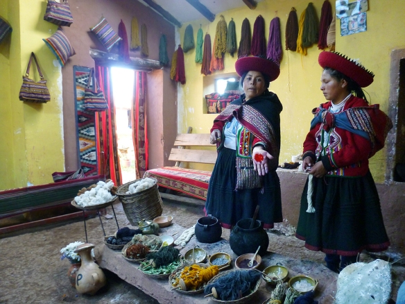 The woman in Chinchero showing how they make the red colour