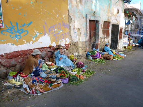 Women selling vegetables at the street... on the street...