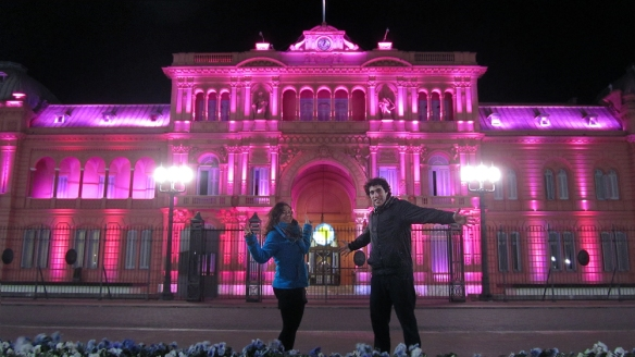 In front of the Casa Rosada at night.