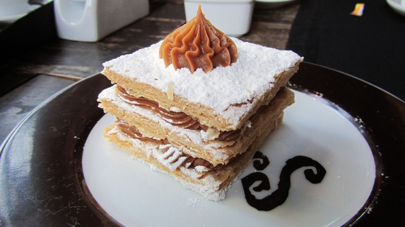 """Trying out the typical Porto Alegre sweat - Mil folhas - meaning """"thousand leaves"""", filled with Dulce De Leche. SOOOOO GOOOOD!!!! It was really perfect!!!"""