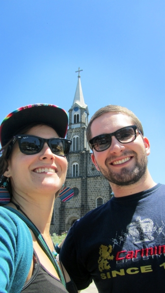 Me and Rafa in front of the church built of stone in Gramado