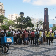 Praca do Ferreira, the main square. People gathered to watch a guy breaking coconuts with his body....