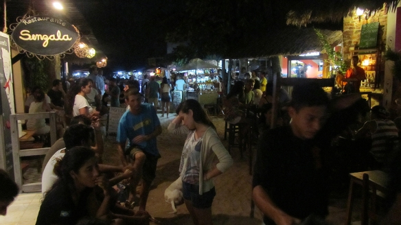 The main street at night, haning outside a pub with live music