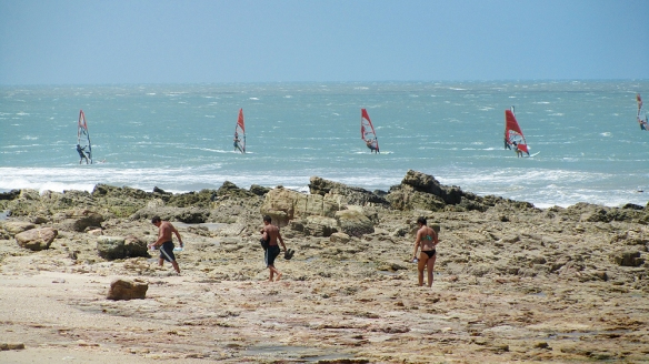 Windsurfers and beach people