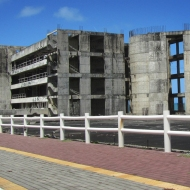 This is also a building that was supposed to be a hotel, but it was something that the workers did one extra floor that wasn't in the contract, so they never finnished it or something.. now it just stands there abandonned by the ocean
