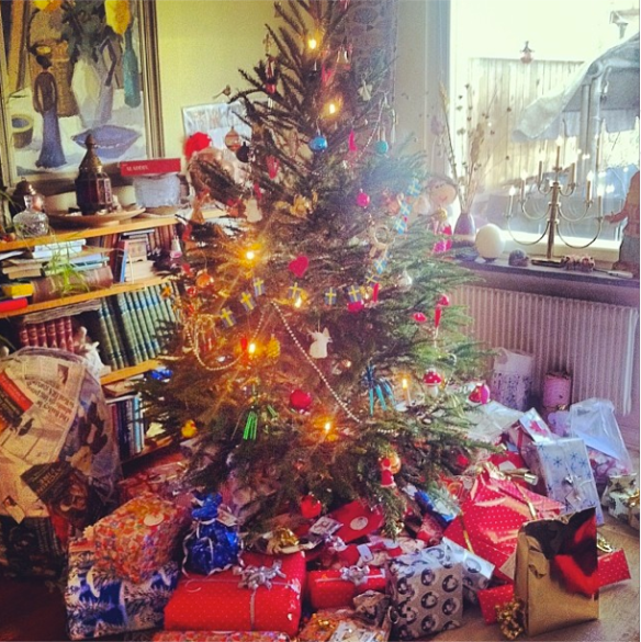 Our christmas tree and all our gifts. Took 7 hours to open them all!