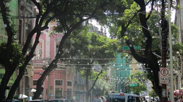 A street in the historical center. I like the round christmas light and the shade of the trees :)