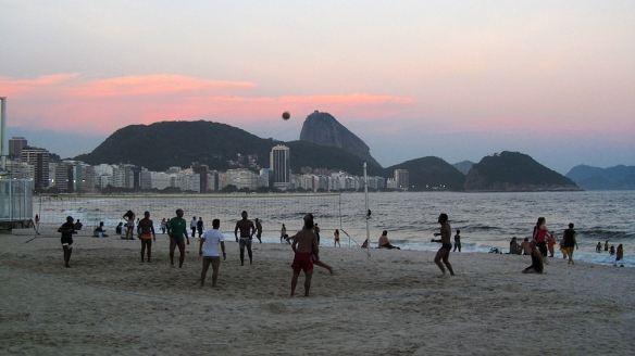Sunset over Copacabana beach. Brazil is the world leading in volley boll.. they play it everywhere