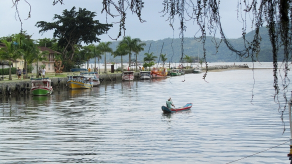 Canoe on the river in Paraty, out to the bay...