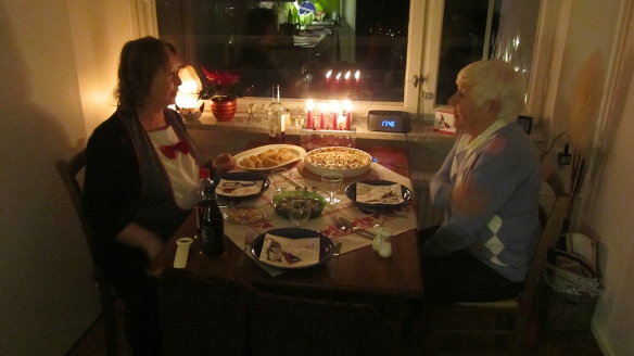 At my mothers on Christmas Eve, having dinner, only us three. :)