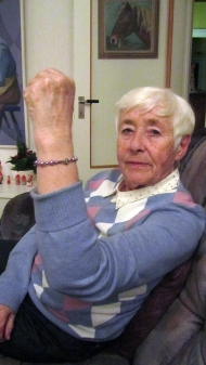My grandmother with her bracelet. She doesn't seem that happy, but she was... haha.