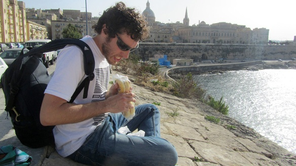 Sitting on the wall in Valetta with a view over to Sliema.