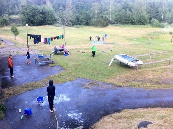 They put a tarp on the grass, sprayed it with water and soap, put on their rain clothes and voilá!