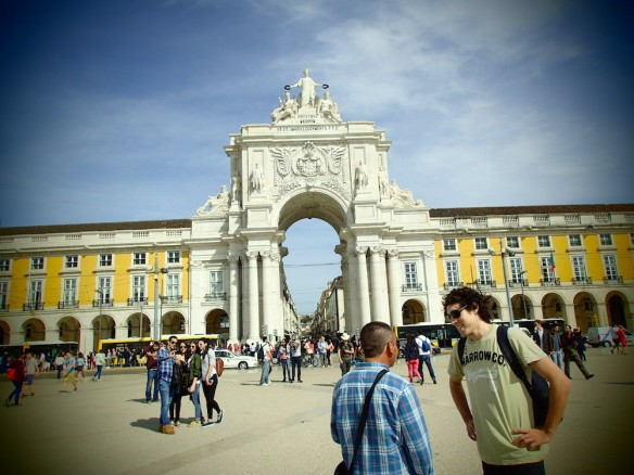 The gate of Praca do Comercio, and a guy trying to sell us drugs