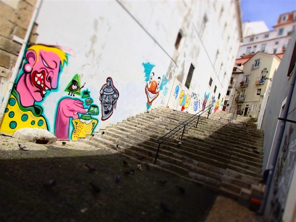 Around alfama on our way up to Castelo Sao Jorge, beautiful grafitti!