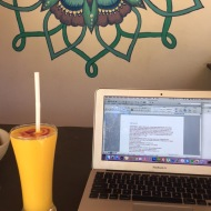 Mango lassi and blog writing at the fake beach