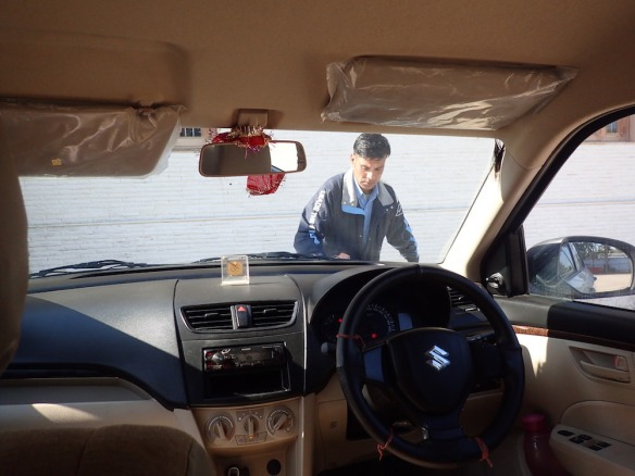 My Driver Mahender is very keen on his car, always washing it and taking of the dust.