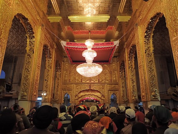 The inside of the temple, all the people waiting in line to go to pray in the altar