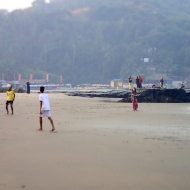 Some kids playing at the mini vagator beach about 8 in the morning on wednesday