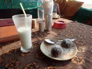 Dried fruits, chocolate and coconut ball with lassi!