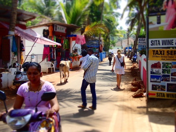 The main street at Agonda. People, cows, dogs, scooters.
