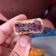 "Bought some ""squared ube snacks"" - it's some kind of purple sweet tomato thing, surprisingly good!"